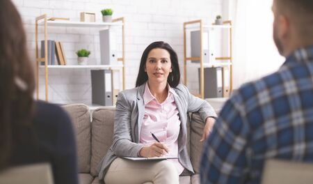 Professional support. Confident psychologist at marital therapy session, looking at camera Stock fotó