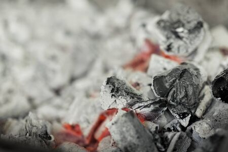 Close up of burnt black coal with red heat in brazier, copy space