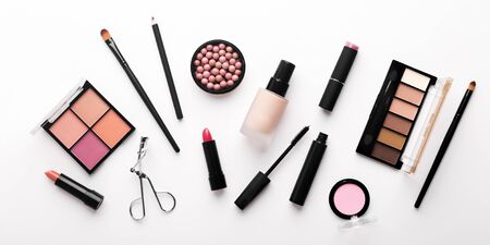 Assortment of luxury cosmetics for every day makeup on white background, panorama