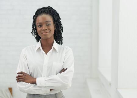 Confident African American Businesswoman Crossing Hands Standing Next To Window Indoor. Business Career. Free Space