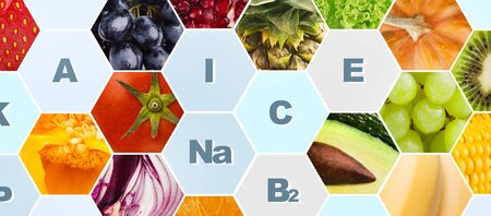 Vitamins and minerals in fruits and vegetables on background, panorama