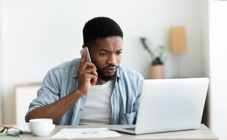 Black millennial guy dialing technical support cause his internet is down, copy space