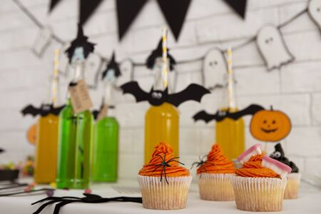 Happy holidays. Close up of Halloween drinks and food for sweet party in office Фото со стока