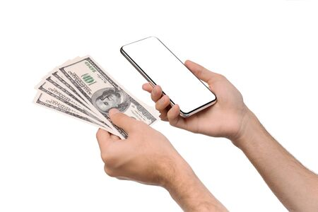 Online credit. Man holding smartphone with blank screen and bunch of dollars, isolated over white background