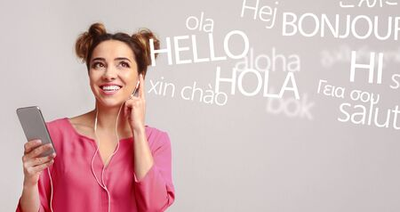Woman with cellphone hearing different languages on grey background, panorama