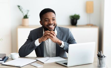 Daydreaming. Pensive african american ceo thinking about bright future of his company, panorama Stock Photo