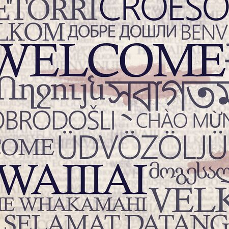 Multinational stand with word welcome in different languages on beige background Stok Fotoğraf