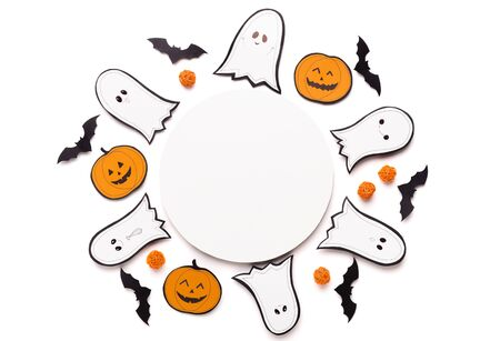 Halloween background for advertisement on round copy space, paper ghosts, bats and pumpkins on white