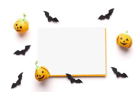 Halloween creative. Autumn Holiday background with copy space for text and smiling pumpkins