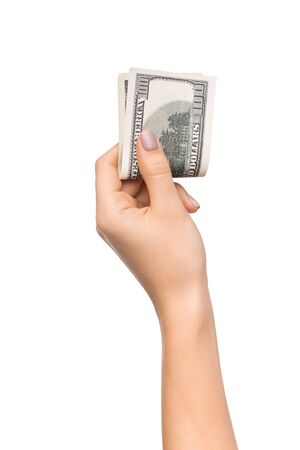 Wise savings. Female hand holding pile of dollars isolated on white background, copy space