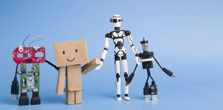 Development of imagination. Four different handmade robots on blue panorama background
