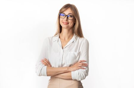 Successful Businesswoman. Positive Lady Smiling At Camera Standing Crossing Hands On White Studio Background. Isolated Фото со стока
