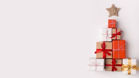 New Year 2020. Handmade Christmas tree made of presents and gifts on white background with copy space for wishes. panorama Stock Photo