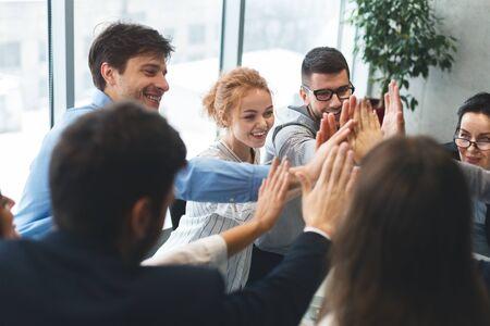 Motivated successful business team giving high five, team building unity concept Reklamní fotografie