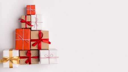 Christmas holiday concept. Creative New Year composition of colorful present boxes on white background, panorama, copy space