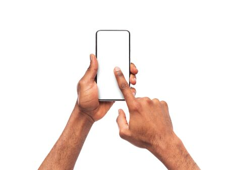 Black mans hands using smartphone with blank screen, isolated on white background, mockup