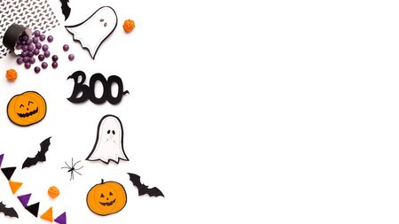 Boo. Halloween conceptual background with paper ghosts and pumpkins on white, panorama, copy space
