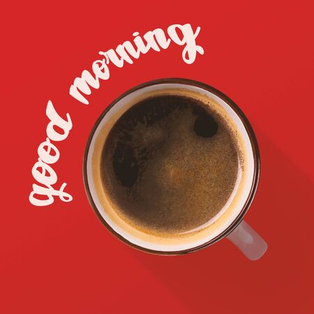 Top view of cup with aroma coffee over red background, morning coffee concept