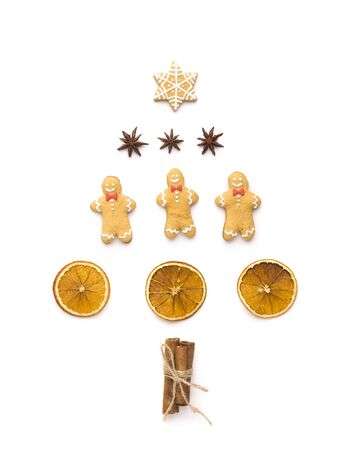 Christmas conceptual. Set for tea with ginger breads in shape of pine tree on white background