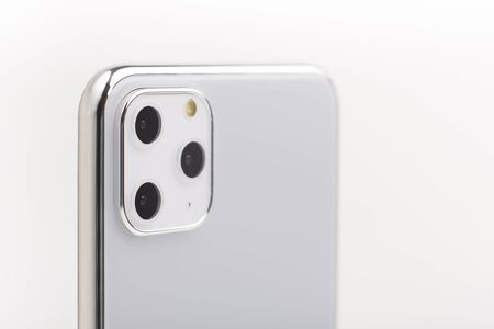 KHARKIV, UKRAINE - OCTOBER 18, 2019: The latest Iphone 11 Pro Max model in silver set with close up of camera review on white background, copy space Banque d'images - 135438184