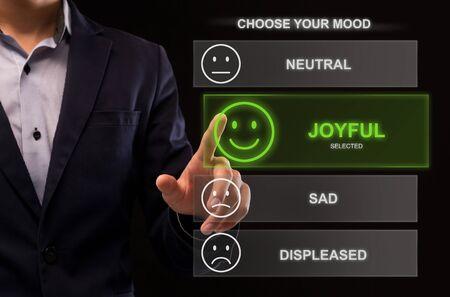 Close Up Of Man Selecting His Mood On Virtual Desktop. The choice between neutral, joyful, sad and displeased mood