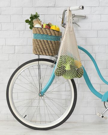 Buy with pleasure for planet. Zero waste shopping bag hanging on retro bicycle, white bricks wall background