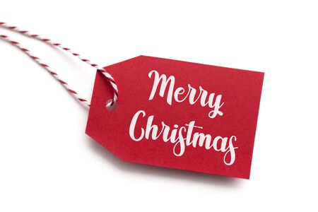 Merry Christmas text handwriting on red label, white background Stock Photo