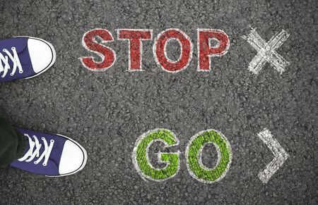 Stop or Go. Person standing at the crossroad and making decision which way to move. Above view.