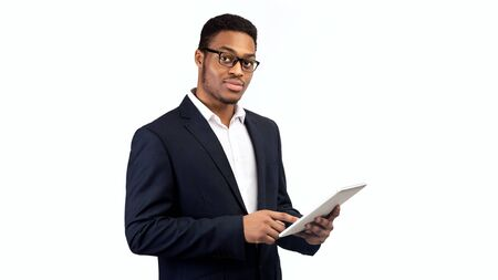 African American Man Holding Tablet, Looking Serious. Panorama, empty space