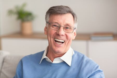 Old Age Happiness. Cheerful Senior Man Laughing Looking At Camera Sitting On Couch At Home. Reklamní fotografie