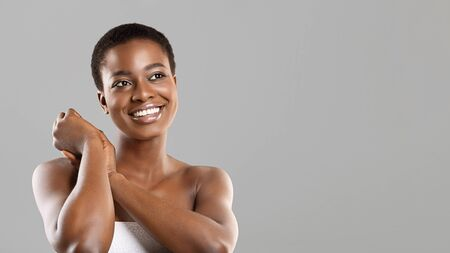 After Spa Beauty Treatment. Portrait of happy beautiful african american girl with flawless skin and perfect smile over gray background, panorama Stock Photo