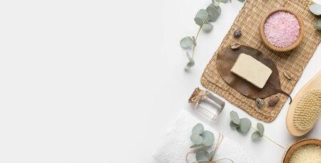 Natural beauty product concept. Homemade soap and eco spa accessories on white background, panorama, copy space