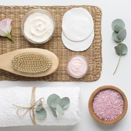 Beauty and fashion concept. Spa set of natural materials and organic sea salt on white background 版權商用圖片