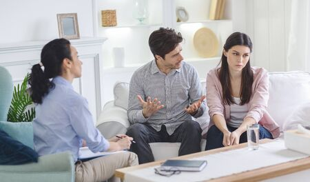 Determined man giving family therapist reasons of cheating wife, familly affair, cheating concept
