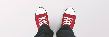 Youth, teenage, student, underground culture concept. Top view of red sneakers over gray background, panorama