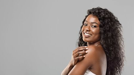 Beauty Portrait. Curly Black Girl With Natural Makeup and White Teeth On Grey Background, Panorama With Copy Space Фото со стока