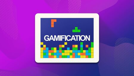Digital tablet with retro video game and word Gamification on screen, purple panorama background