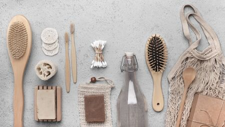 Zero waste supplies for personal hygiene. Bamboo bath accessories and eco soap on gray background