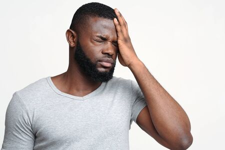 Brain diseases problem cause chronic severe headache. Young black man tired and stressed, having mental problem trouble, medical concept