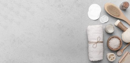 Plastic free concept. Bamboo brush, eco sea salt and cotton towel on gray background, panorama, copy space