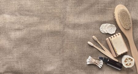 Spa organic natural accessories of bamboo on brown towel, panorama, copy space