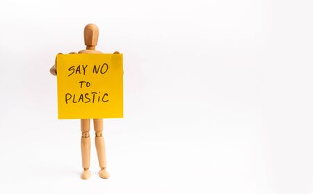 Save clean earth, say no to plastic. Wooden mannequin with banner isolated on white background, copy space