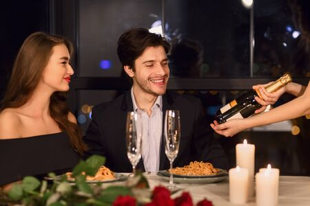 young couple having dinner in restaurant, choosing wine Banque d'images - 137190502