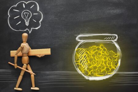 Money for startup, startup supporting. Image of wooden man creator with idea in his head going towards jar with money