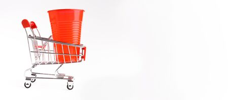 Global environment problem. Shopping cart with plastic waste isolated on white background, wide panorama, copy space Imagens