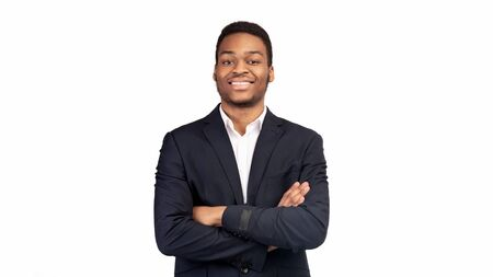 Leader Concept. Successful black entrepreneur standing with folded arms over white background. Panorama, empty space