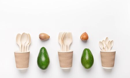 Avocado pit biodegradable single-use cutlery. Eco plastic- Great alternative to plastic disposable tableware, white background, copy space Stock Photo