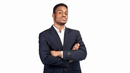 Confident Salesman. Happy afro guy standing with crossed arms isolated over white background. Panorama, copy space Stock Photo