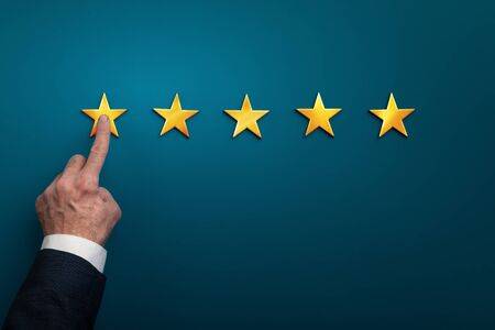 Hand of businessman touching one star symbol, low rating of company concept, Copy space background