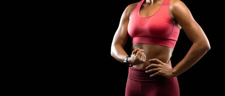 Cropped of sporty afro girl flexing arm muscles over black background, panorama with copy space Banque d'images - 138298315